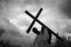 Everyone has his cross (Andrey  B. Barhatov) Tags: light urban blackandwhite bw sculpture cloud black art film monument monochrome clouds contrast analog dark noir mood cross noiretblanc russia moscow grain dramatic monotone urbanexploration msk monuments ru bnw urbansculpture citywalk moskva  analogphoto  citywalks   russianfederation whiteonblack  olympusmjuii adox   moscowwalks analoguephotography  blackandwhiteonly muzeon artinbw olympusmjuii filmtype135 filmoriginal  bnwfilm withoutanyprocessing  filmfilmforever adoxsilvermax adoxsilvermax100 msknoir barhatovcom bnwmood  bnwdark olympusmjuiimjuii