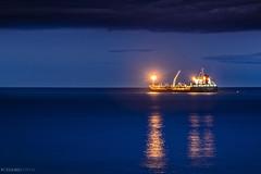 B T Caleta Rosario (Mauro Esains) Tags: patagonia atardecer luces mar agua ciudad playa cerro cielo nubes comodoro reflejos buque chubut tanque rivadavia calmo destellos