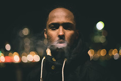 Malique (khalidamakran) Tags: light shadow urban man fashion skyline dark rotterdam bokeh cigarette smoke citylights maliquemohamud