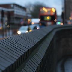 Black Wall (No Great Hurry) Tags: bus brick london texture wall square lights poplar traffic bokeh depthoffield rushhour allsaints eastlondon redbus blackwall robinbarr nogreathurry robinmauricebarr
