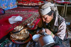 A Tajik woman drinking solted milk tea, Tashkurgan (inchiki tour) Tags: travel people house highway village tea snapshot uighur xinjiang silkroad karakoram kkh  uyghur traveling tajik centralasia  chai pamir  chay  2015 tashkurgan  taxkorgan karakoramhighway tashkorgan