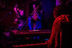 Warm-up (Melissa Maples) Tags: red musicians bar club night turkey dark nikon keyboard asia purple mask bass trkiye band nightclub antalya bassist trombone nikkor instruments vr afs trombonist musicalinstruments  keyboardist 18200mm  f3556g kaleii  18200mmf3556g d5100 ethnicfun