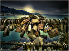 Cefal Love Locks (Luc V. de Zeeuw) Tags: sea italy sun mountain love water coast rocks cloudy lock sicilia cefal lovelocks