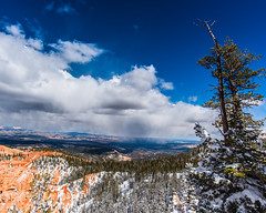Bryce Canyon 15 (MarcCooper_1950) Tags: trees red sky orange snow colors clouds landscape utah nikon scenery rocks vivid canyon cliffs hills southern boulders hoodoo bryce rainfall hdr formations lightroom mounatins brycecanyonnationalpark geologic d810 marccooper