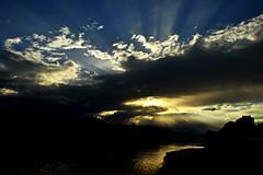 Haaveilla. (ihlai.) Tags: blue light sunset shadow sky cloud sun sunlight reflection sunshine silhouette yellow clouds sunrise river skyscape landscape lights mirror florence nikon view cloudy skylight sunsets shades firenze arno sunrises