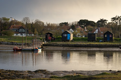Across the River Blyth (garybroughton05) Tags: uk trees sunset england color colour nature water ferry reflections river golden suffolk spring still scenery harbour scenic calm huts mooring late serene southwold tranquil eastanglia blyth walberswick sonya7