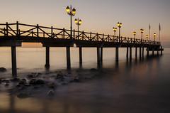 El embarcadero al alba (J Fuentes) Tags: orange costa sol del sunrise luces long exposure flickr save amanecer embarcadero mlaga marbella iluminacin largaexposicin