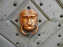 Kraków (kenjet) Tags: door architecture europe pattern head poland structure knocker brass kraków doorknocker