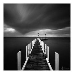 Darkest Days (Laws Photography | www.lawsphotography.com) Tags: longexposure blackandwhite bw seascape monochrome weather skyline clouds canon dark square landscape pier outdoor jetty fineart le squareformat ndfilter daytimelongexposure neutraldensityfilter longshutterexposure nd10stop lawsphotography vaughanlaws longexposurebwfineart