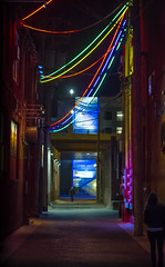 Neon Alley II (vinnothkrishnan) Tags: life street people abstract building art film lamp colors night outside photography alley neon outdoor streetphotography experiment frame