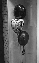 Valentine's Day soon (Man with Red Eyes) Tags: monochrome analog advertising blackwhite kodak balloon rangefinder valentine lancaster shopwindow nikkor tmax400 50mmf14 shopdisplay semistand silverhalide pyrocathd bessar2s