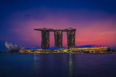 Singapore & Sunset (Luís Henrique Boucault) Tags: ocean travel sunset sea seascape night reflections lights singapore asia nightshot casino traveling sg architeture marinabaysands