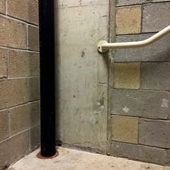 Black Pipe (cdsessums) Tags: black pipe stairwell handrail cinderblock