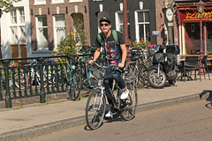 Bilderdijkkade - Amsterdam (Netherlands) (Meteorry) Tags: street boy west holland male guy netherlands sunglasses amsterdam bike bicycle oudwest canal europe cyclist candid kade nederland sneakers trainers quay september baskets lad rue bicyclette unionjack mn paysbas quai vlo jacobvanlennepstraat homme noordholland gracht bilderdijkkade 2015 altra meteorry tzonnetje ouest skets amsterdampeople