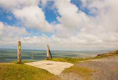 View from the cliff path. (Phillloyd fotographie) Tags: blue white seascape green grass wales skyscape concrete notice cliffs aberystwyth signpost gravel woodenposts foreversummer canon40d rokinon14mm may2015