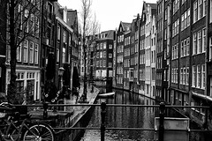 Amsterdam Canal (jtat_88) Tags: holiday dutch buildings architecture water canal travelphotography amsterdam snapseed contrast bw mirrorlesscamera mirrorless sonya7 sony 10faves vacation bicycles boat