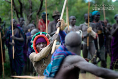 Donga, more than a ritual fight. Le Donga, bien plus qu'un combat rituel. (Patricia Ondina) Tags: africa canon fight fighter action african tribal violence omovalley colourful anthropologie ethiopia fighting combat surma anthropology color afrique hornofafrica ethiopian omo eastafrica donga thiopien suri etiopia abyssinia travelphotography ethiopie etiopa guerrier etiopija ethnie omoriver ethnies  africanculture omopeople etipia  africantribe afriquedelest photosdevoyage  ritualfight  africanrift valledelomo  sagin ethicpeople combatrituel rivireomo riftafricainpeuplesdelomoomopeopleportraitethnologieethnologyethnictributribetribal