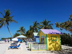 Stay a Little While (grinnin1110) Tags: beach seaside outdoor palmtrees shore northamerica caribbean bahamas whitesand atlanticocean eleuthera cabanas princesscays beachumbrella beachbungalow beachloungers privatebungalow exumasound cruise2016 privateportofcall westerlyside