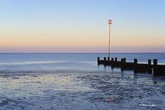Incoming (Ali Ly) Tags: sea sky sunrise landscape 50mm dawn coast sand pastel tide norfolk clear groyne heacham nikond810 sigmaart leelittlestopper