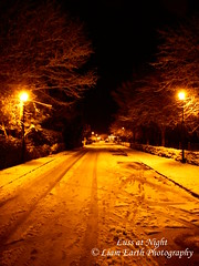 DSCN0036 (liamearth) Tags: road street trees red orange snow streetlight luss