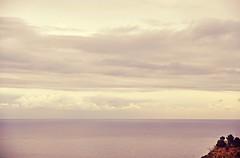a piece of earth in the sea, in the sky (L C L) Tags: sea sky españa grey gris mar andalucía spain cloudy earth cielo nublado almería mediterráneo tierra mojácar plomizo lcl nikond90 loretocantero