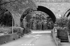 Road under the bridge. (pstone646) Tags: road blackandwhite monochrome kent streetphotography tunnel archway railwaybridge