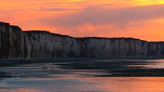 3 Silhouettes on the beach (KerKaya) Tags: ocean leica pink blue light sunset sea sky orange 3 seascape reflection beach nature water colors silhouette clouds landscape lumix coast three purple cliffs panasonic shore serenity normandy kerkaya