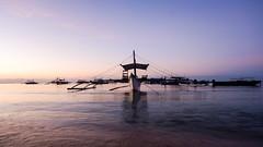 Dawn on seashore (Hendraxu) Tags: ocean morning travel sea water sunrise dawn boat seaside philippines seashore traveldestination