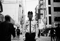 Good man (Jiajun Yang) Tags: street people bw blackwhite streetphotography commercial monochrone