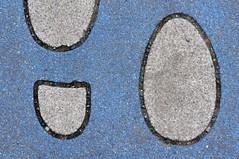 Sign on the Ground / Zeichen am Boden (bernhard.friess) Tags: blue original light white black art texture sign vintage germany lens concrete deutschland prime licht march spring interesting europa europe fotografie kunst sony egg 85mm pedestrian struktur best explore blau alpha 18 popular uncropped manualfocus schwarz mrz pfalz ei bernhard beton frhling genuine rheinlandpfalz zeichen rheinhessen manuelle weis badkreuznach fussgnger canonfd interessant klassisch entdecken friess emount fdnex nex5n canon85mm118fd