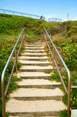 Bicyclist on top of the Concrete Stairway at Wollongon Beach (Markus Jaaske) Tags: travel sea beach grass architecture stairs landscape concrete outside outdoors coast sand support outdoor path background sandy cement steps peaceful australia down stairway staircase walkway shore coastline bicyclist handrail footpath pathway balustrade wollongong baluster