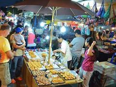 Sunday market in  (kawabek) Tags: thailand market stall chiangmai          parsol