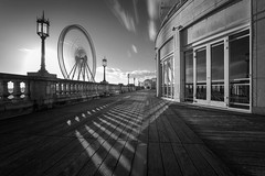 Interference (S l a w e k) Tags: city uk longexposure travel shadow england wheel clouds sussex seaside brighton europe cityscape play sunny resort boardwalk seafront speeding madeiradrive spinnig