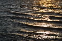 Wind on the River (Elizabeth Almlie) Tags: sunset river waves shore