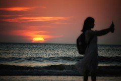 Sunset Selfie Taker (leewoods106) Tags: trip travel sunset red vacation people orange woman holiday silhouette yellow lady canon outside person photography photo holidays asia southeastasia photographer photos journey malaysia borneo traveling sabah beautifulview beautifulmoments traveler selfie beautifulplaces beautifulsunset beautifulisland offthebeatentrack beautifulimage wonderfulplaces beautifulseascapes photobomber mustseeplaces incredibleplaces canoneosm canonefs55250mmstm