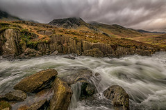 Go with the Flow (einir.leigh) Tags: uk winter mountains color colour water rain wales clouds rural river walking nikon women rocks stream britain outdoor welsh snowdonia rugged gwynedd northwales ogwen ogwenvalley