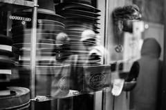 Hats (Paul David Price) Tags: street people blackandwhite reflection london window wet rain reflections photography construction hats piccadilly rainy hood raining damp