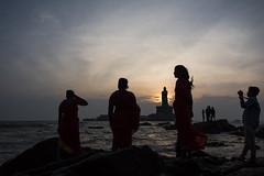 Sunrise Watchers (Ravikanth K) Tags: street morning people india beach water silhouette statue rock sunrise four women rocks outdoor photographers tourists southern tip shore cape tamilnadu kanyakumari thiruvalluvar vivekananda comorin 500px nikond750
