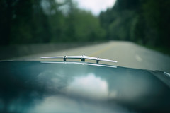 On the open road (Eric Flexyourhead (shoulder injury, slow)) Tags: blue canada detail 1955 car zeiss silver emblem bc bokeh britishcolumbia chrome american northshore badge hood pontiac bonnet vignette westvancouver fragment shallowdepthoffield cypressprovincialpark starchief 55mmf18 cypressbowlroad pontiacstarchief stupidlyshallowdepthoffield sonyalphaa7 zeisssonnartfe55mmf18za