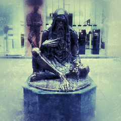 Begger statue