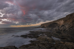 Cape Carnot Caves (Schlingshot Photography) Tags: sunset sea crimson clouds coast rocks cliffs caves swell crimsonskies southerocean tonykemp schlingshot
