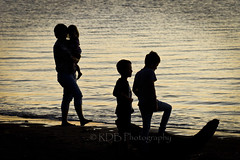 Family in Silhouette (ArdieBeaPhotography) Tags: ocean family sea two beach boys girl coast waves quiet child waterfront little brothers sister walk small daughter mother calm mum shore serene ripples carry placid