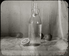 Still Life with Bottle and Lemons (MargoLuc) Tags: light bw stilllife texture window kitchen glass fruit vintage table bottle soft mood sony lemons agrumi skeletalmess ilce6000