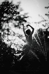 JUMP... (privizzinis passion photography) Tags: light boy summer people blackandwhite water monochrome childhood children fun outdoors happy jump child play outdoor joy sprinkler