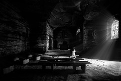Solitude X (Sb Mory) Tags: light people blackandwhite bw black film church monochrome switzerland nikon solitude noir suisse noiretblanc lumire nb fribourg nikkor madeleine glise srie serie grottes 1424 d700