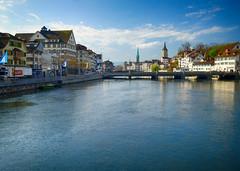 Limmat River view in Zurich, Switzerland (` Toshio ') Tags: city bridge clouds river switzerland europe european suisse swiss zurich clocktower limmat toshio limmatriver xe2 fujixe2