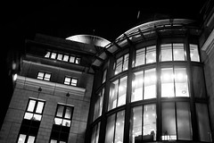 Plaza Tower (CarnivoreDaddy) Tags: city blackandwhite bw building tower night dark lights blackwhite office nikon angle perspective handheld curve nocrop uncropped highiso blindshot 35mmf18 primelens d3200