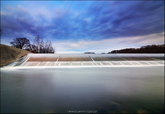 Momentum of Water   Lake Charleston Spillway (StormLoverSwin93   Into the Storm) Tags: longexposure blue sky motion water weather clouds canon dark landscape photography waterfall twilight circularpolarizer spillway waterscape charlestonillinois 60d canon60d canoneos60d colescountyillinois