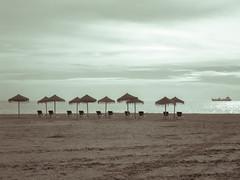 La playa estaba desierta y el mar no baaba tu piel (antoine pirulier) Tags: andaluca barco playa mlaga horizonte sombrillas lnea hamacas playadelamalagueta lamalagueta mlagaciudad