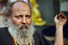 staring & smoking baba | Kolkata (arnabchat) Tags: old winter portrait india man face look beard eyes asia dof smoke smoking hindu hinduism kolkata baba calcutta pilgrim sankranti holyman 2016 sanyasi 50m18 arnabchat